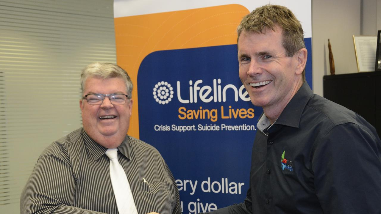 VITAL FUNDING: Lifeline Darling Downs and South West Queensland CEO Derek Tuffield is thrilled after the organisation received $10,000 in funding from CS Energy CEO Andrew Bills in Toowoomba.