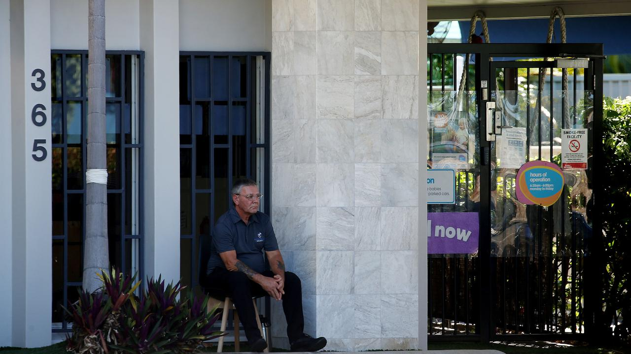 A security guard keeps watch at the door of the Goodstart daycare centre on Sheridan St, Cairns North. Picture: Stewart McLean.
