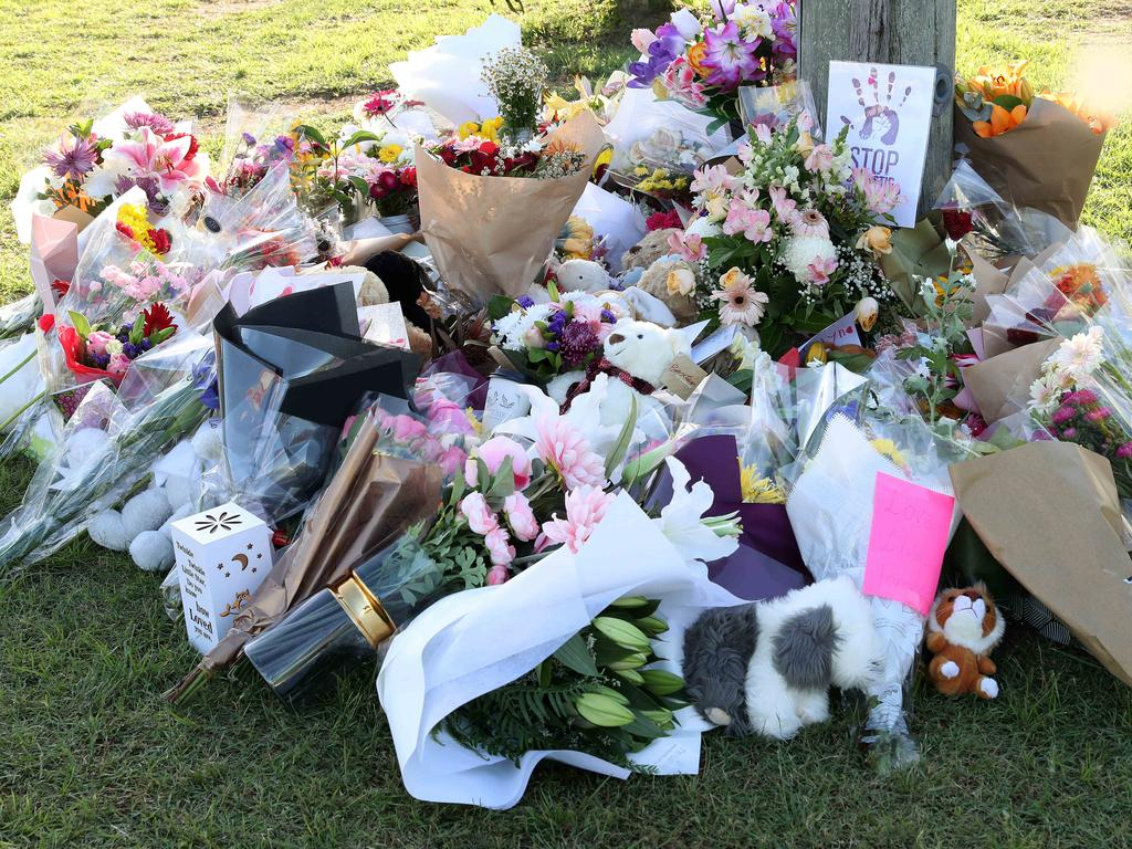 Flowers at the scene of the car fire in Camp Hill. Picture: Liam Kidston