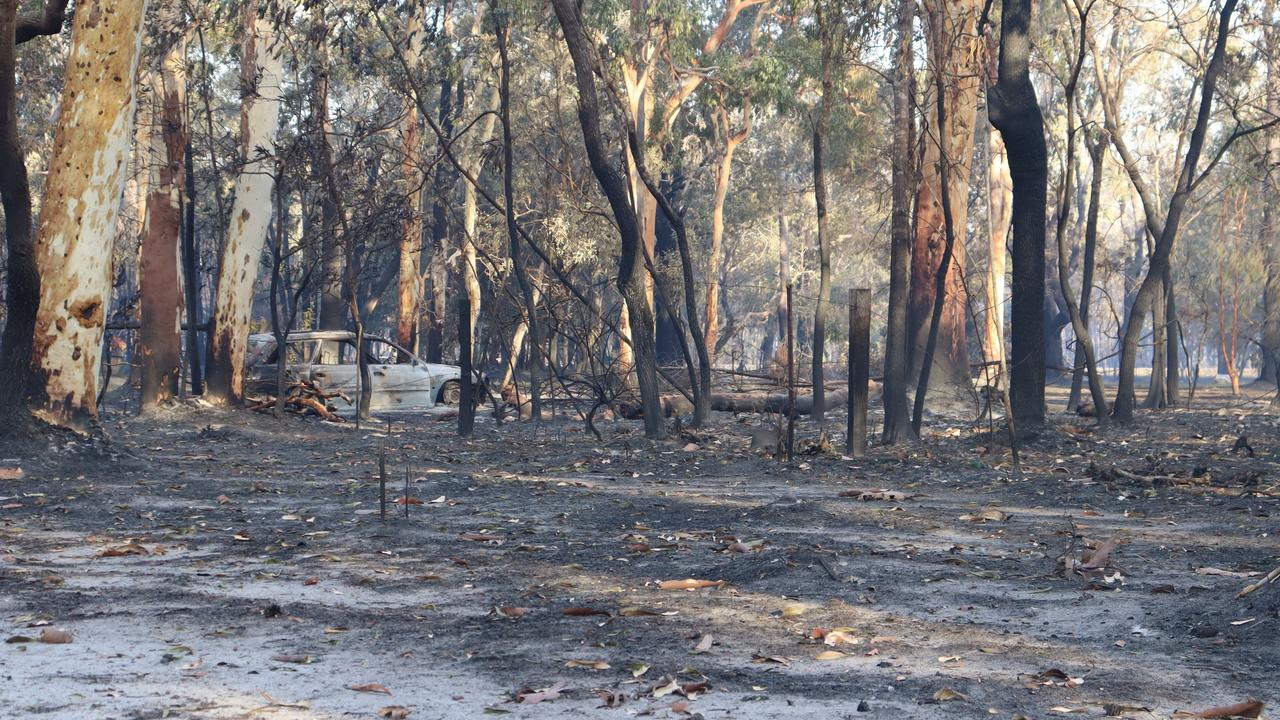 A burnt out car at Cooroibah after the fires had struck hard.