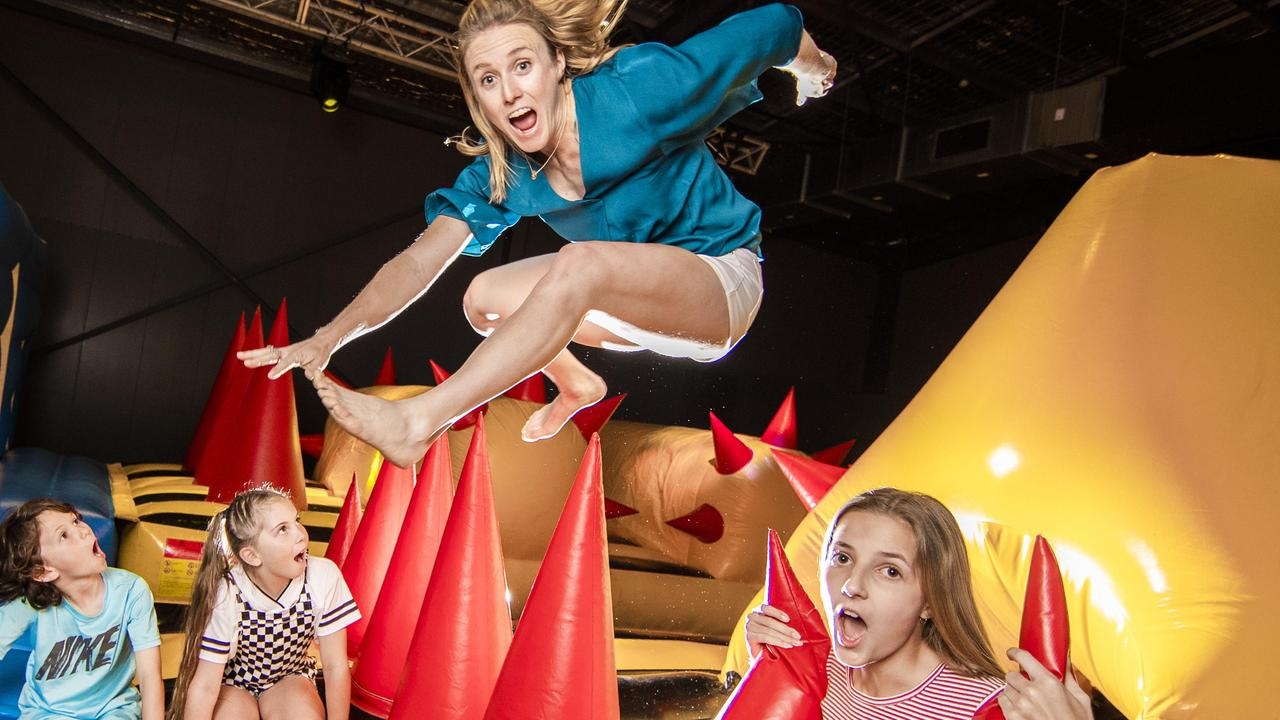 Gold Coast kids Jae Chapman, 9, Kyra Sutton, 9 and Alexandra Cotterill, 13 watch in awe of golden girl and ex Olympic hurdler Sally Pearson as she takes on Dreamworld's newest attraction just in time for the school holidays, The Monster. Picture: NIGEL HALLETT