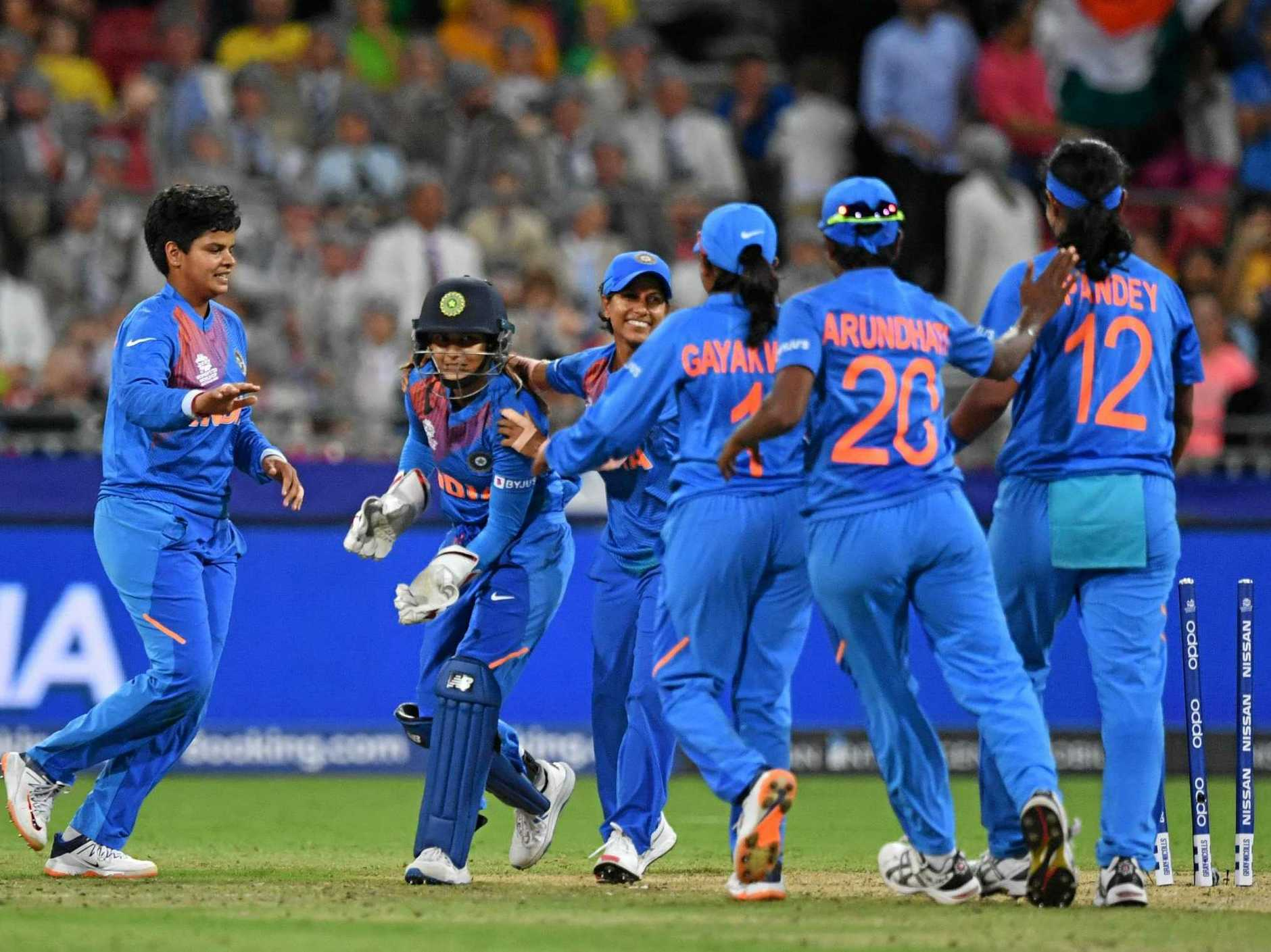 India celebrate after Taniya Bhatia's stumping of Australia's Annabel Sutherland during their T20 World Cup cricket match in Sydney on Friday night. Picture: Dean Lewins/AAP