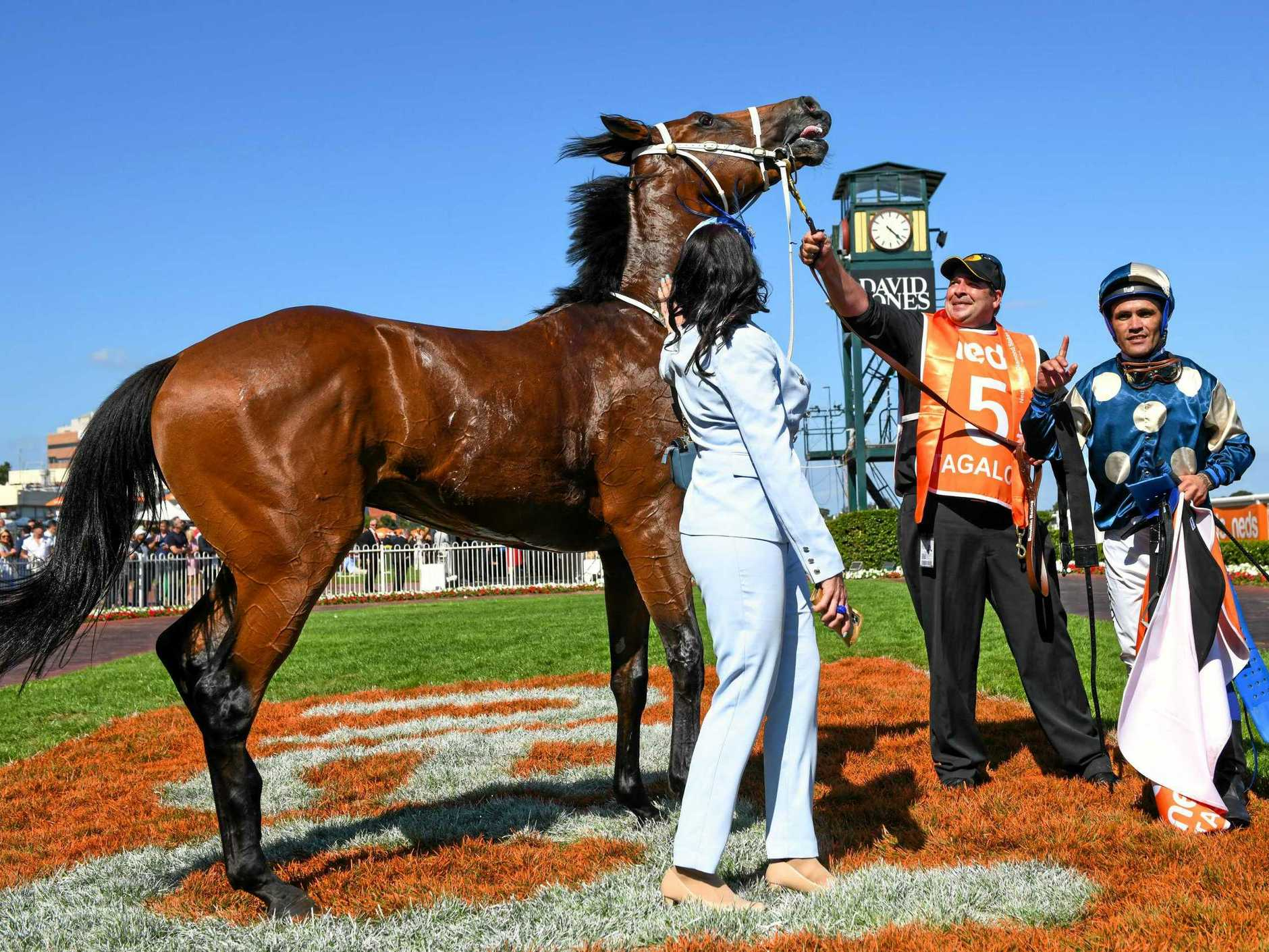 Jockey Michael Walker returns to scale with trainer Natalie Young after riding Tagaloa to victory in Blue Diamond Stakes. Picture: Vince Caligiuri/AAP
