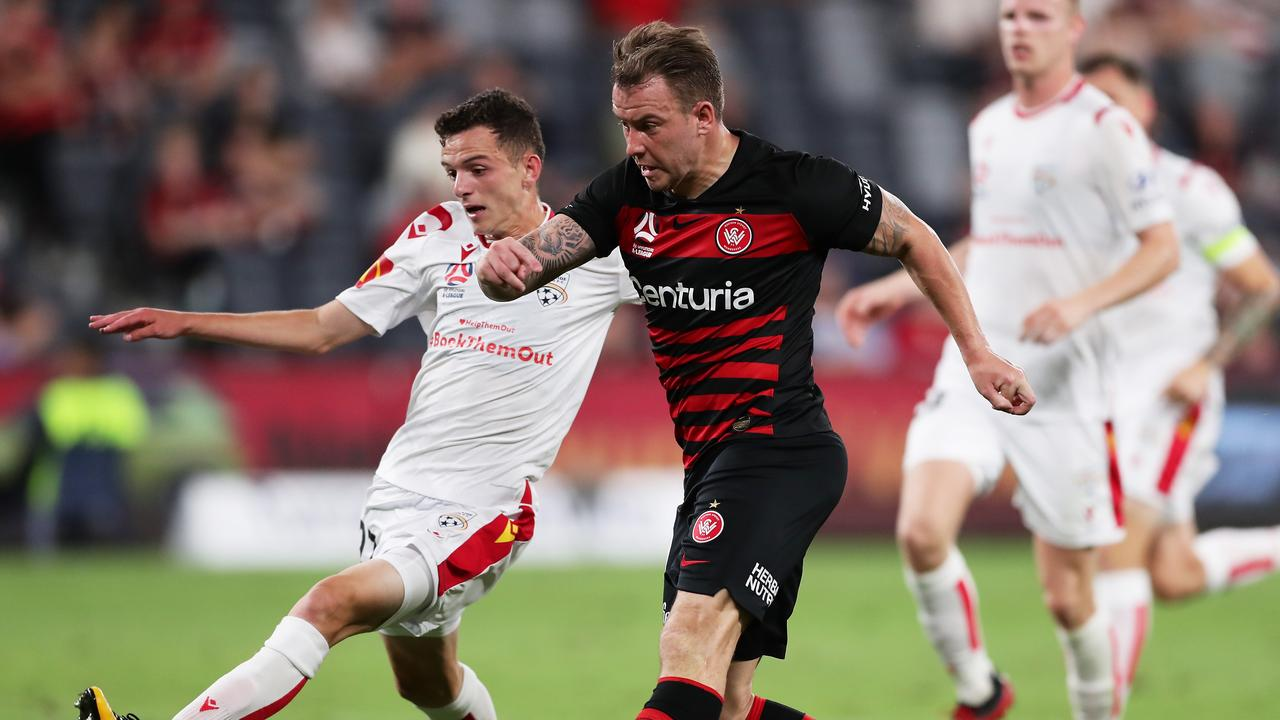 Western Sydney's Simon Cox takes a shot on goal with Adelaide United's Louis D'Arrigo close by at Bankwest Stadium. Picture: Matt King/Getty Images