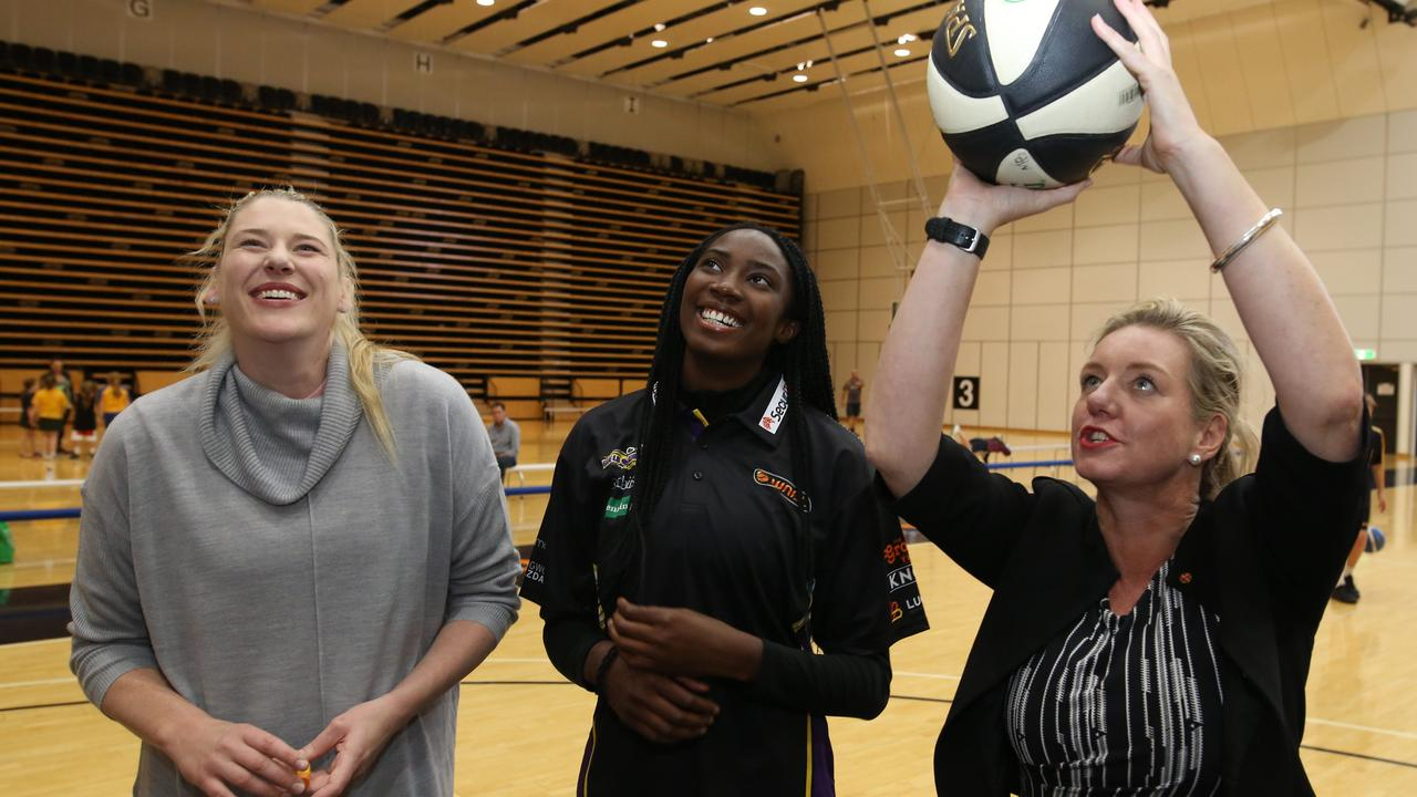 Ezi Magbegor with Lauren Jackson and then sport minister Bridget McKenzie. Picture: Stuart Milligan