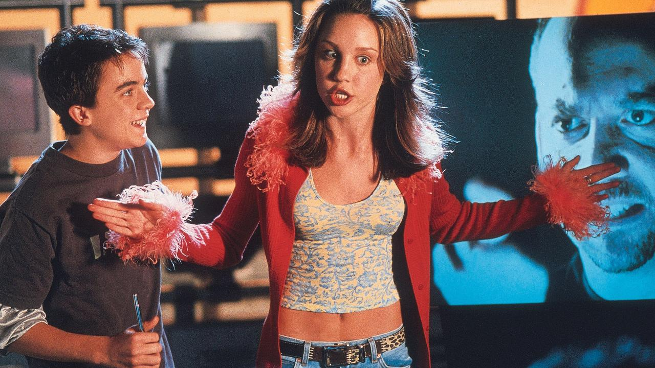 Actor Amanda Bynes with Frankie Muniz in scene from film Big Fat Liar.