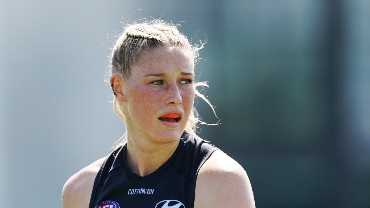 Carlton star Tayla Harris has offered to give up her wage in a passionate series of posts, begging the AFL to take action against online harassment.