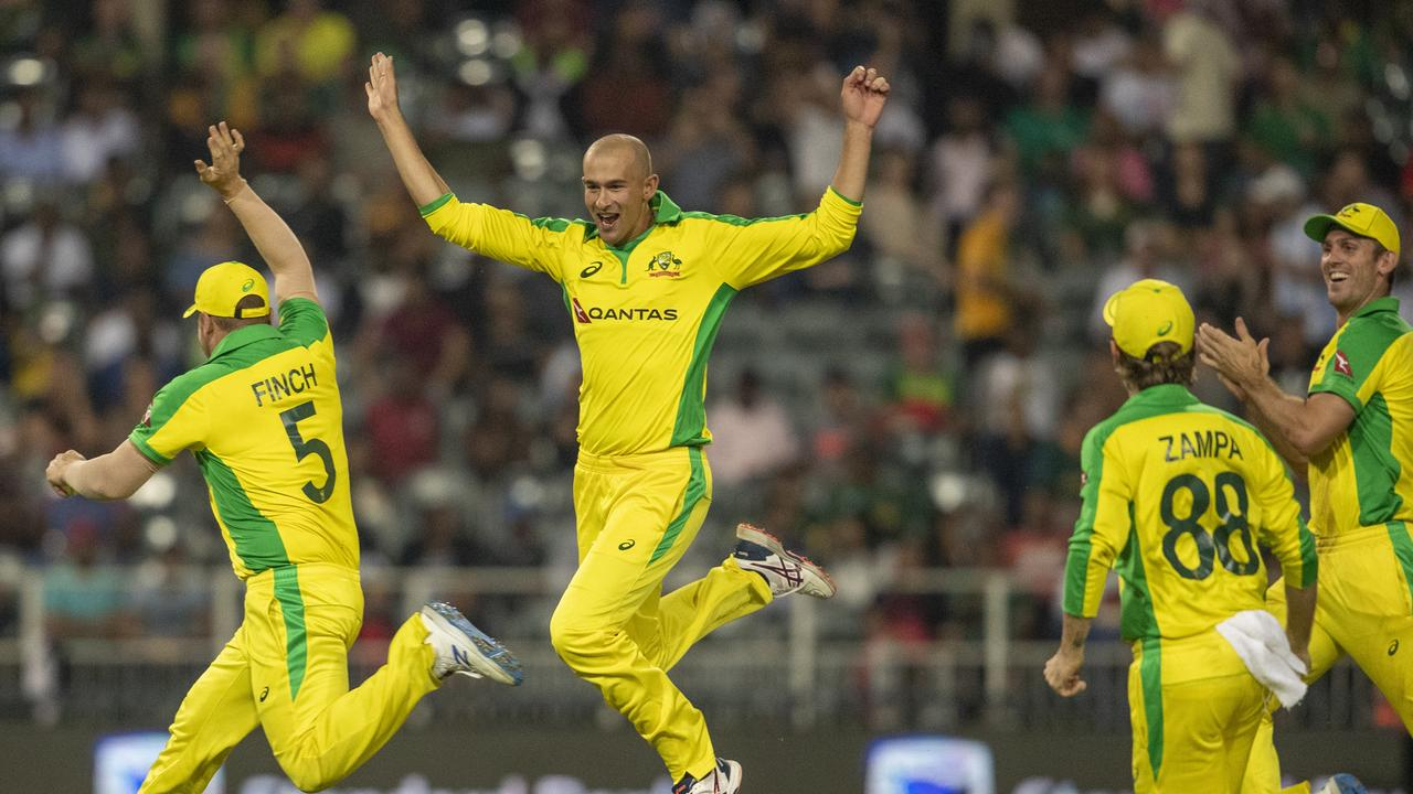 Ashton Agar, second from left, celebrates with teammates after dismissing Dale Steyn. Picture: Themba Hadebe/AP