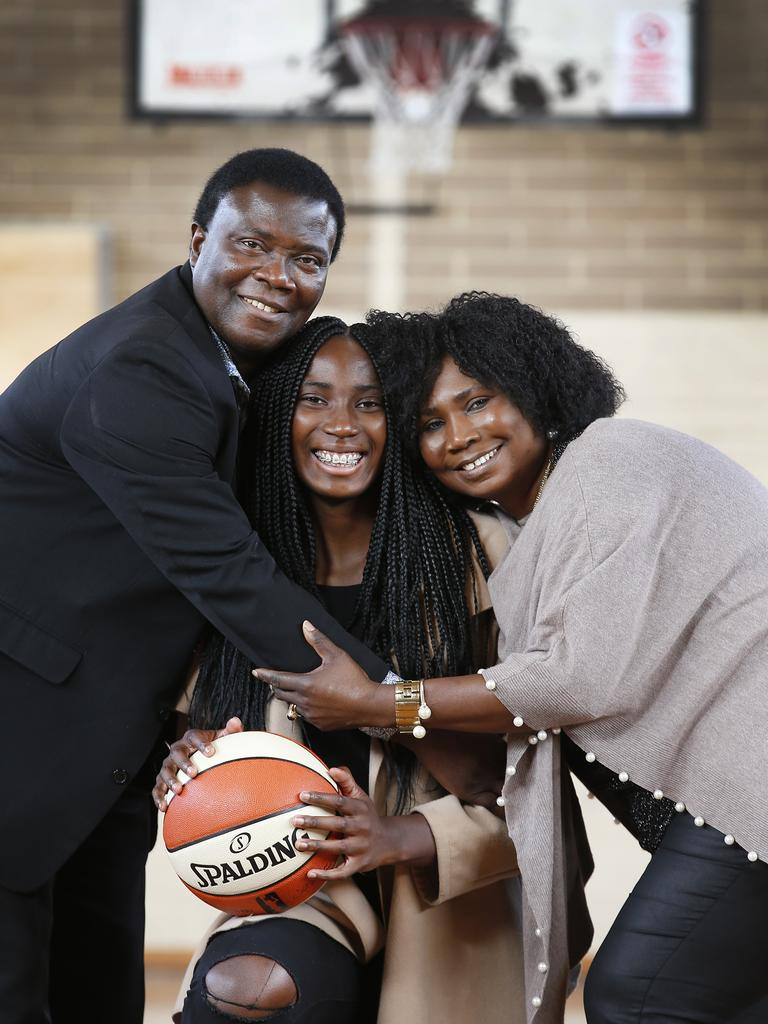 Ezi Magbegor with her proud parents Appolus and Patience after her selection in the WNBA draft by the Seattle Storm. Picture: David Caird