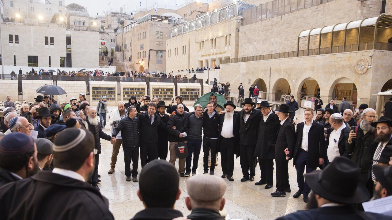 Jewish Orthodox men gather during a mass prayer at the Western Wall for coronavirus patients in Jerusalem's Old City on February 16, 2020. Picture: Amir Levy/Getty Images