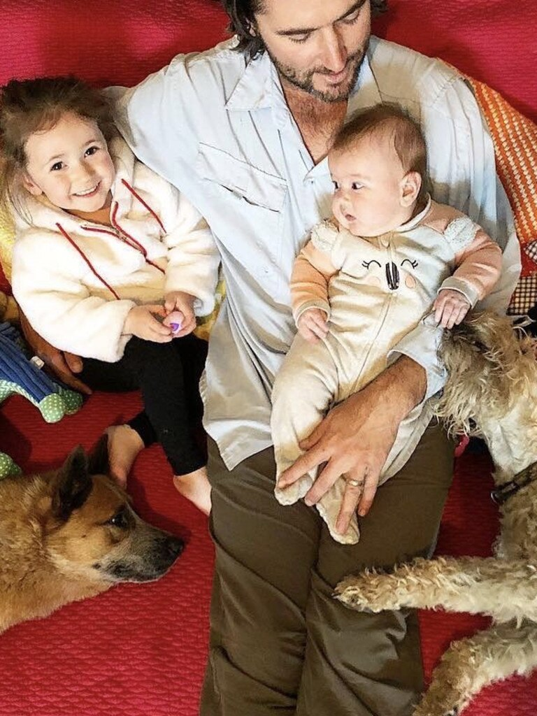 Bliss: Luke Evans with daughters Elle and Evie, his own dog Tilly (left) and an overnighter. Dogs that stay over join the family.