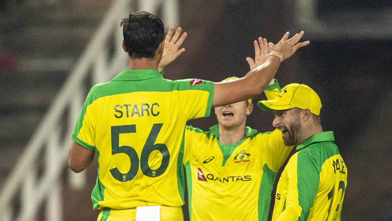 Australia's bowler Mitchell Starc, left, celebrates with teammates after bowling South Africa's captain Quinton de Kock during the 1st T20 cricket match between South Africa and Australia at Wanderers stadium in Johannesburg, South Africa, Friday, Feb. 21, 2020. (AP Photo/Themba Hadebe)