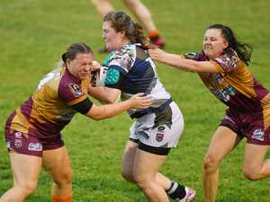 Country player Tegan Rolfe (left) tackles Citys