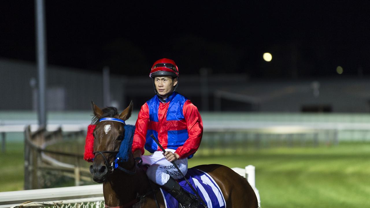 Jabalic and Noriyuki Masuda return to the winners stall after. Picture: Kevin Farmer