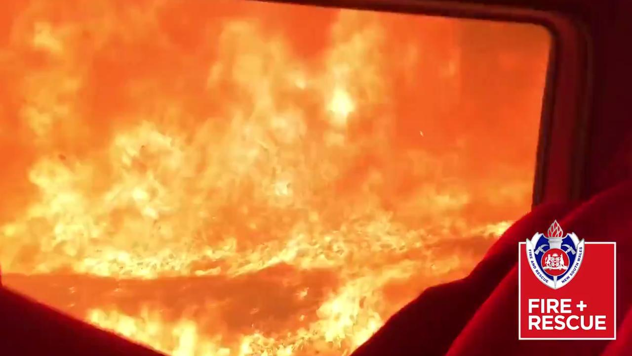 The crew from Fire and Rescue NSW Station 509 Wyoming recorded this video showing the moment their truck was overrun by the bushfire burning South of Nowra. Picture: NSW Fire and Rescue