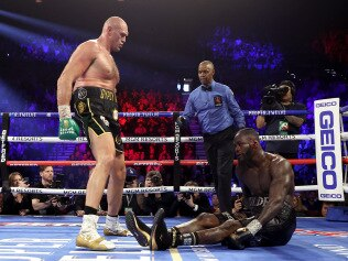 LAS VEGAS, NEVADA - FEBRUARY 22:  Tyson Fury knocks down Deontay Wilder in the fifth during their Heavyweight bout for Wilder's WBC and Fury's lineal heavyweight title on February 22, 2020 at MGM Grand Garden Arena in Las Vegas, Nevada. (Photo by Al Bello/Getty Images)