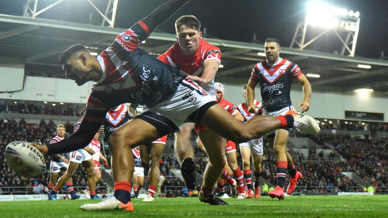 Daniel Tupou scores a try for the Sydney Roosters. Picture: Nathan Stirk/Getty Images
