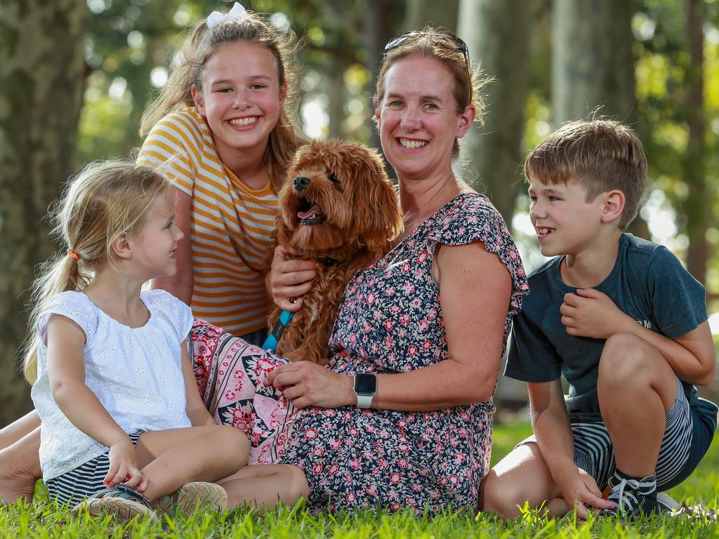 Felicity Hughes with her children and her 8 month-old Cavoodle, Arlo. Picture: Justin Lloyd