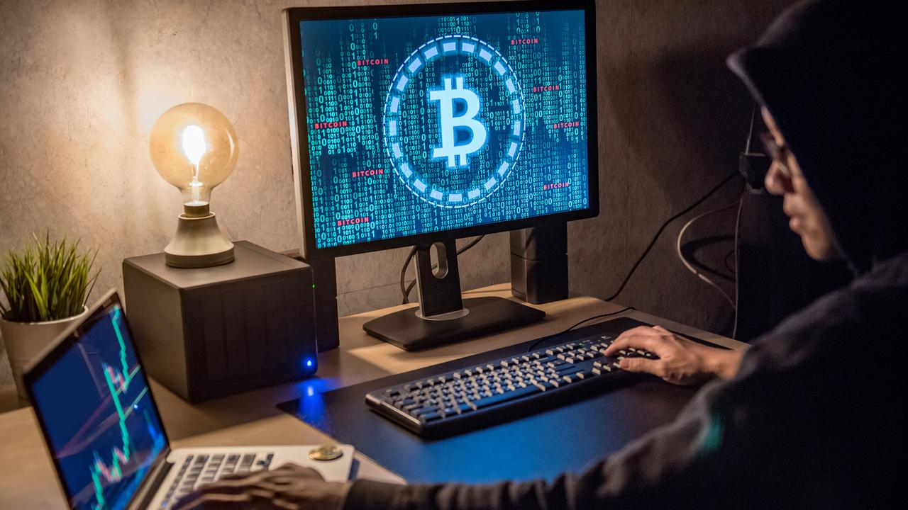 A stock image of a man using Bitcoin.