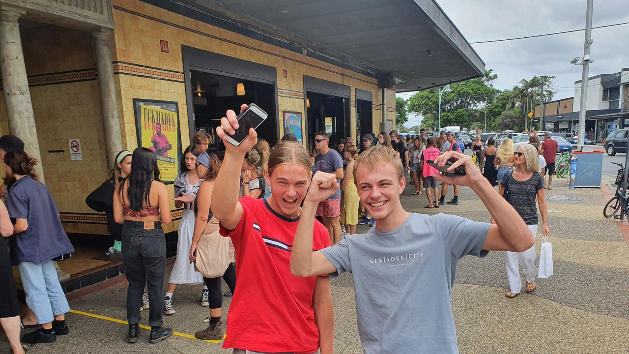 GOT 'EM: Oliver Walsh (left) and Jasper Tiffen, from Stokers Siding, we're excited to get their tickets for the Splendour in the Grass music festival after a three-hour wait at Byron Bay on Sunday. The locals' tickets were only available to those living in certain postcodes in the region.