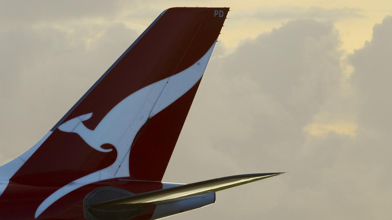 Generic pics of Sydney Airport. Qantas logo on tail of plane. Pic Jenny Evans