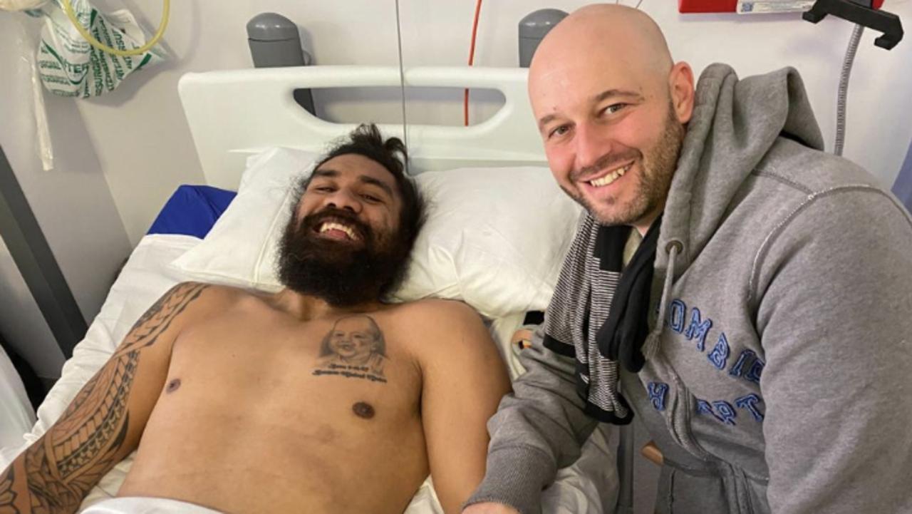 Mose Masoe is visited in hospital by NRL boss Todd Greenberg.