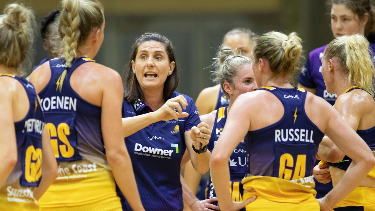 Sunshine Coast Lightning coach Kylee Byrne speaks with Cara Koenen and Jacqui Russell during a trial game at USC Stadium against West Coast Fever. Photo: Barry Alsop