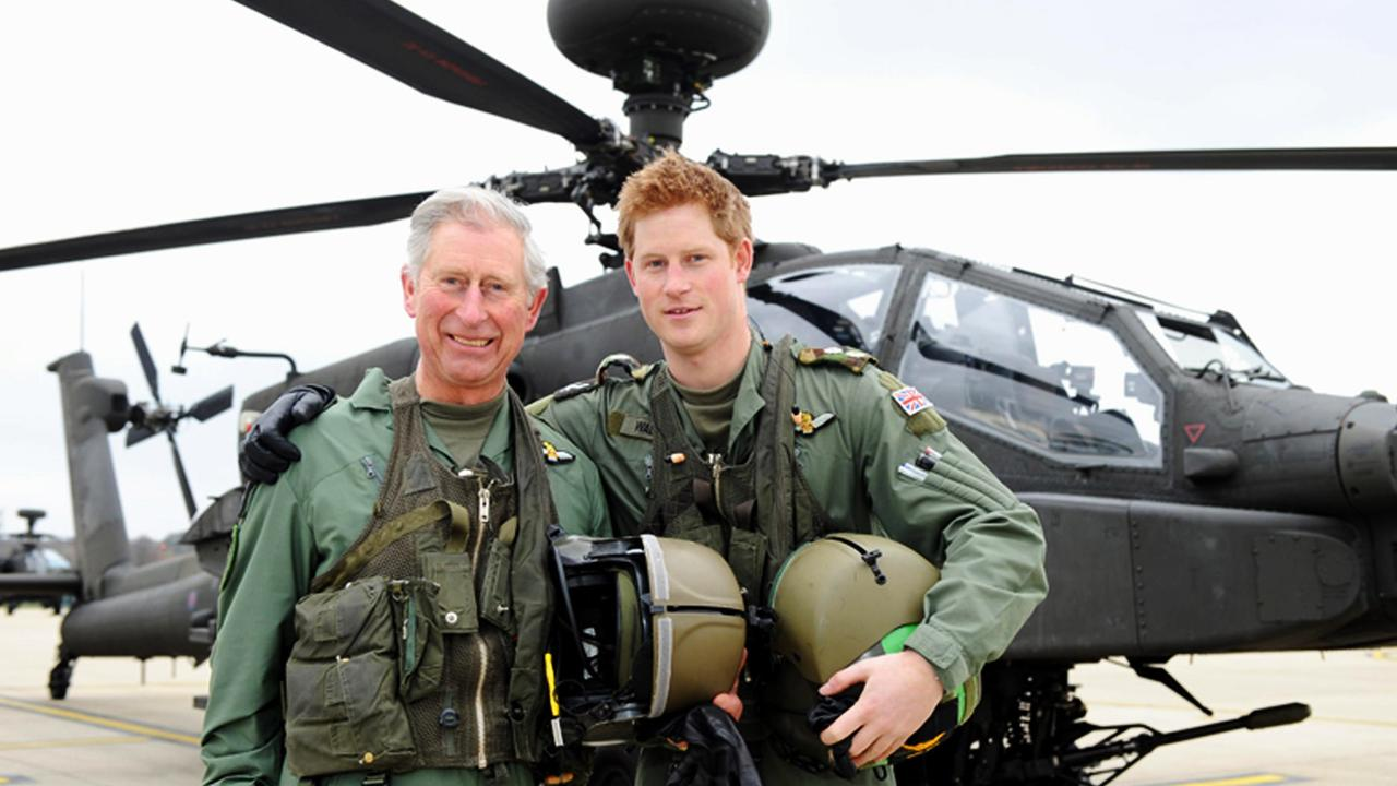 Prince Harry and his father, the Prince Charles, Prince of Wales, in front of an Apache Helicopter in 2011. Picture: Richard Dawson/MoD via Getty Images
