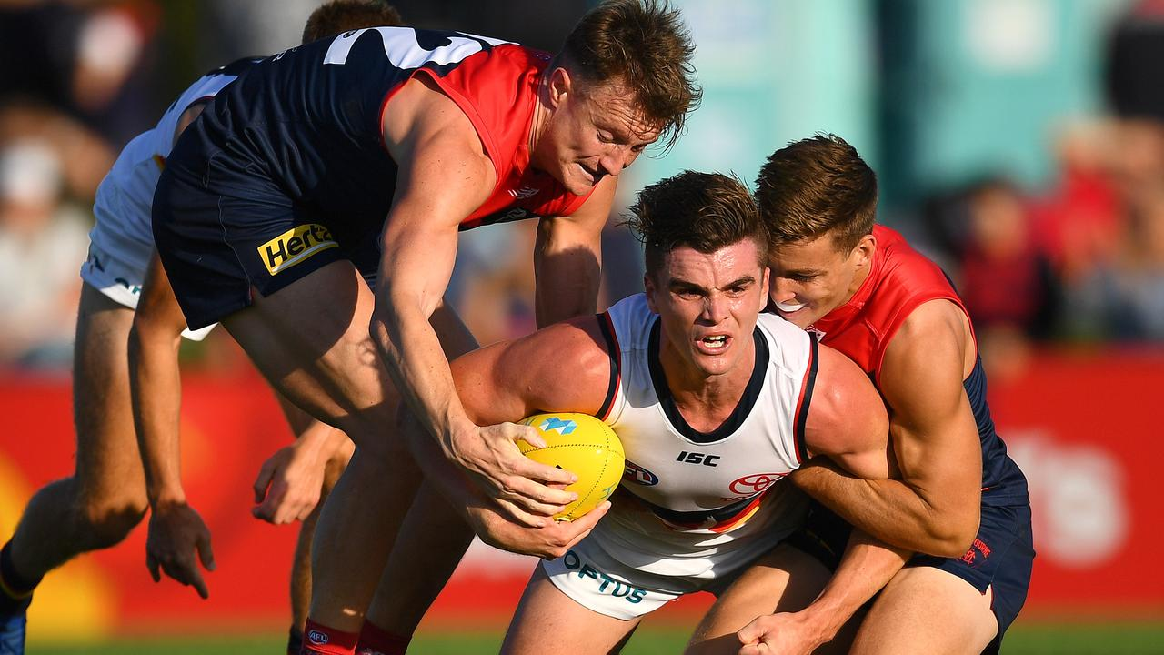 Aaron vandenBerg tries to wrench the ball from Adelaide's Ben Keays during Saturday's Marsh Series fixture.
