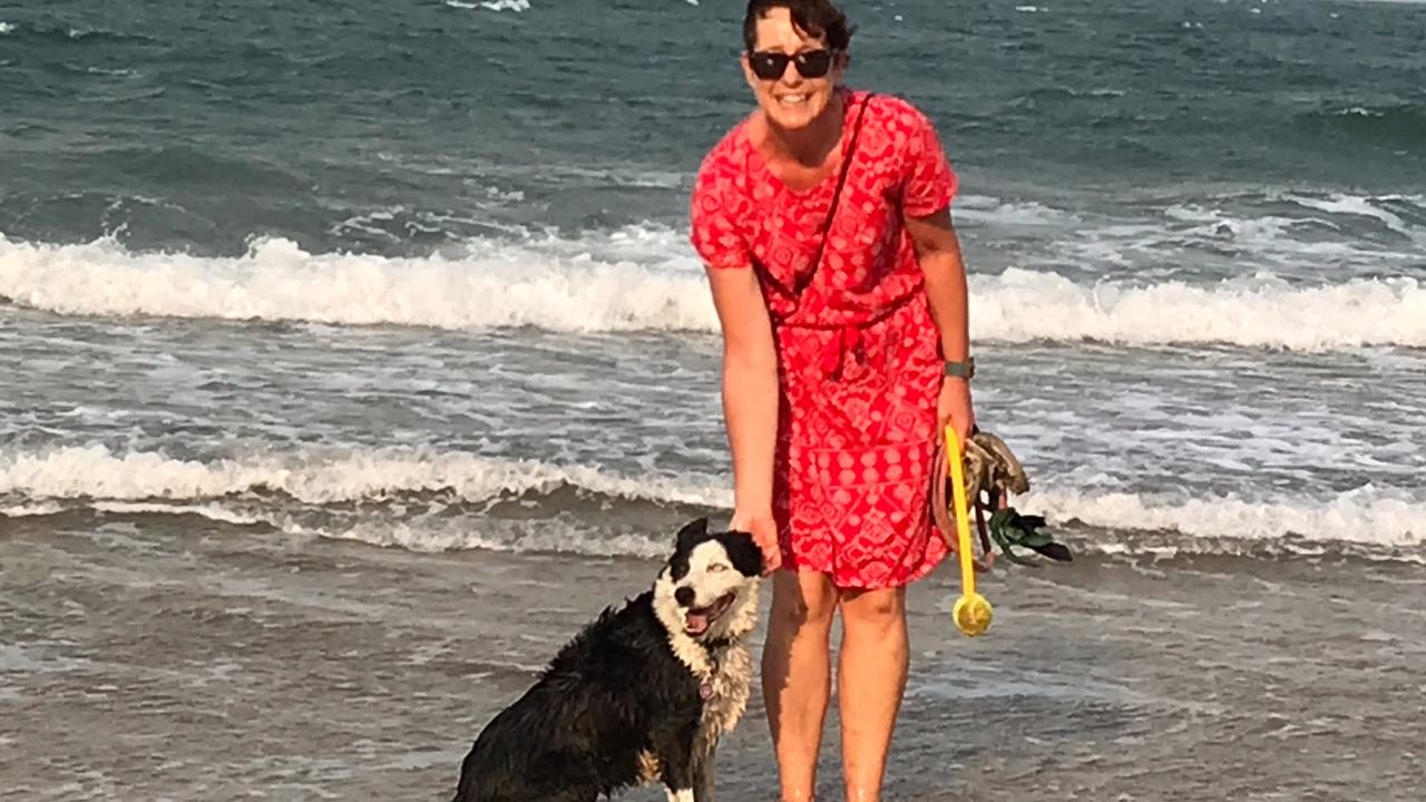 Denise Macartney with her dog Lily at Tannum Beach.