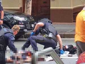 Knifeman killed by cops in CBD shooting chaos