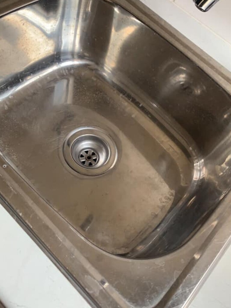 BEFORE: This photo shows what the laundry sink looked like before it was cleaned using the highly sought out Bar Keepers Friend. Picture: Facebook/mumswhoclean