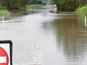 Stranded motorist rescued from car stuck in floodwater