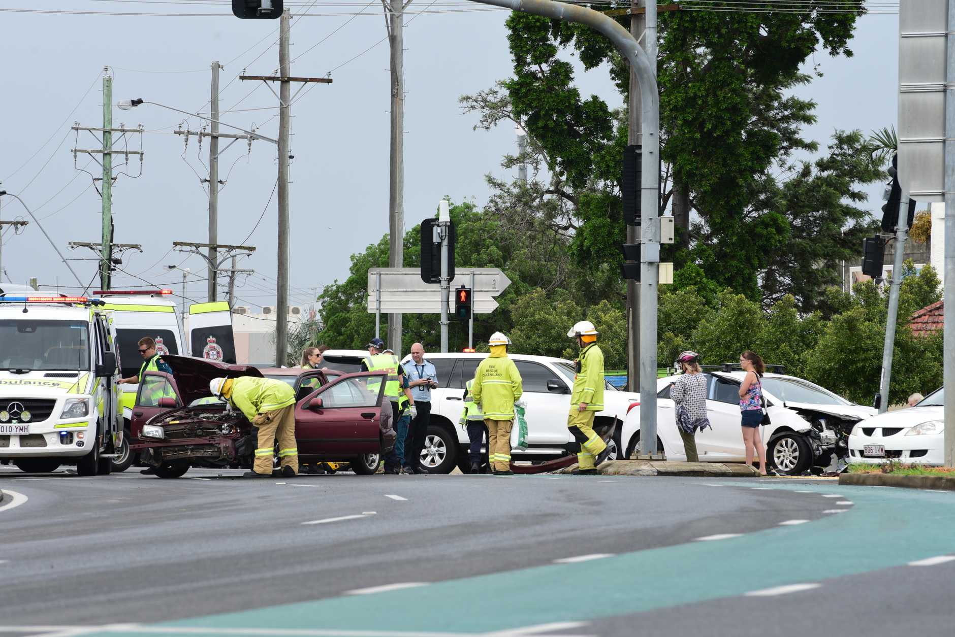 Crews tend to the scene of the smash on Bourbong St.