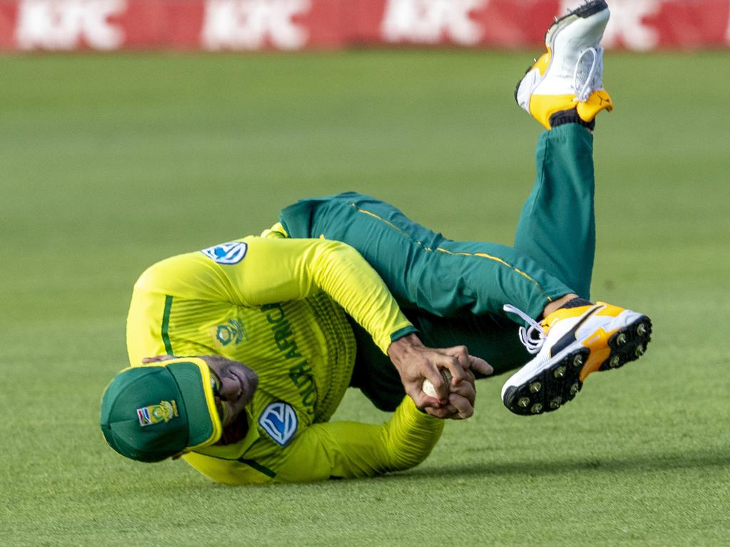 South Africa's Faf du Plessis takes a spectacular catch to dismiss Australia's batsman Steven Smith for 29 runs. Picture: AP Photo/Themba Hadebe