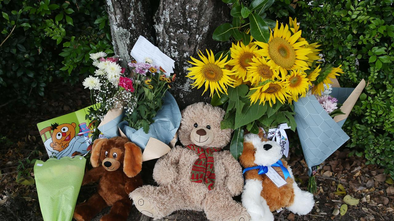 Members of the public left flowers and teddies at the Goodstart Early Learning Centre. Picture: Brendan Radke
