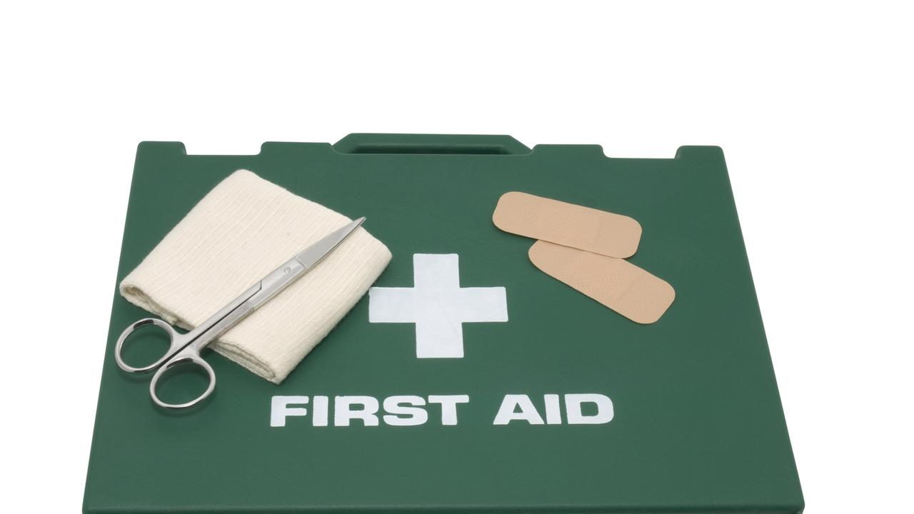 First aid kit isolated on background