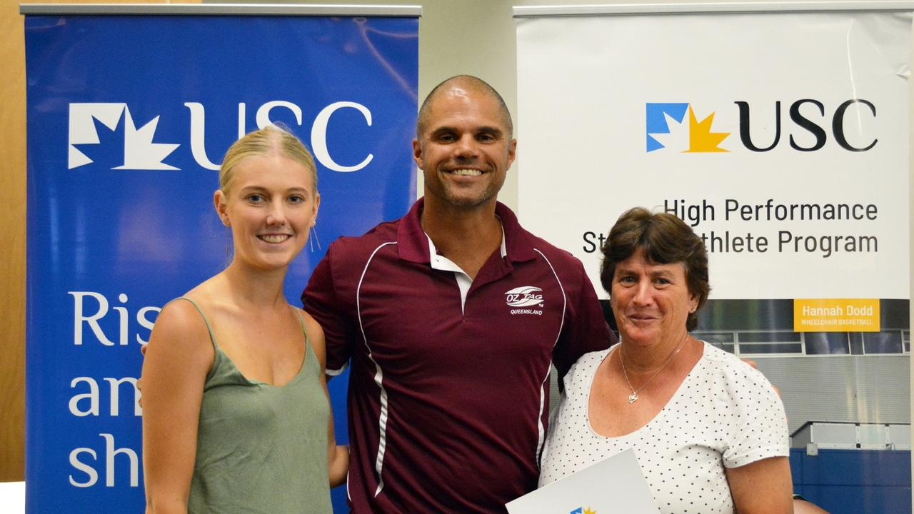 Brendan Powell presents the Oztag scholarships to Tessa Campbell and Rachael Harper's mother Lisa Ney.