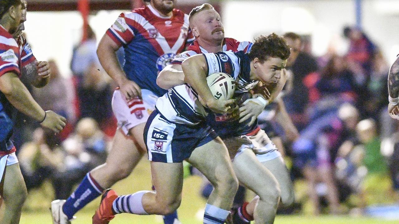 Brothers' Jayke Collin is tackled during their A-Grade match against Calliope Roosters.