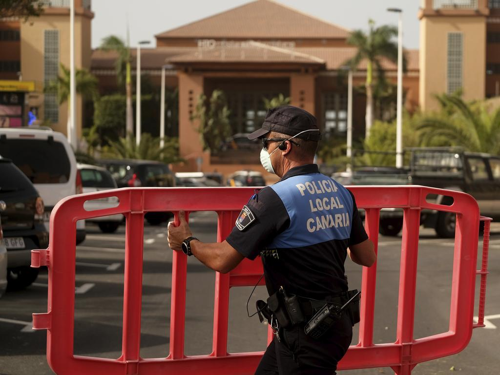 A Spanish police blocks access to the resort where 1000 guests are staying. Picture: AP Photo.