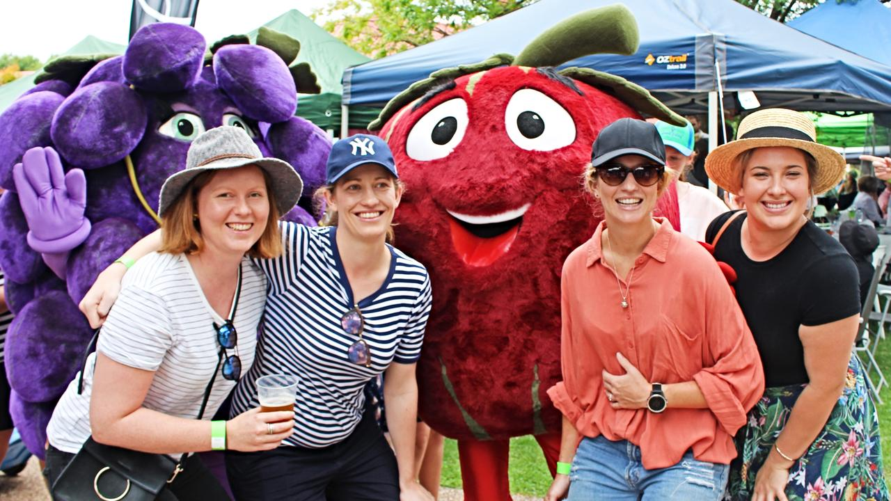 Apple and Grape mascots with excited punters at 2018's event.