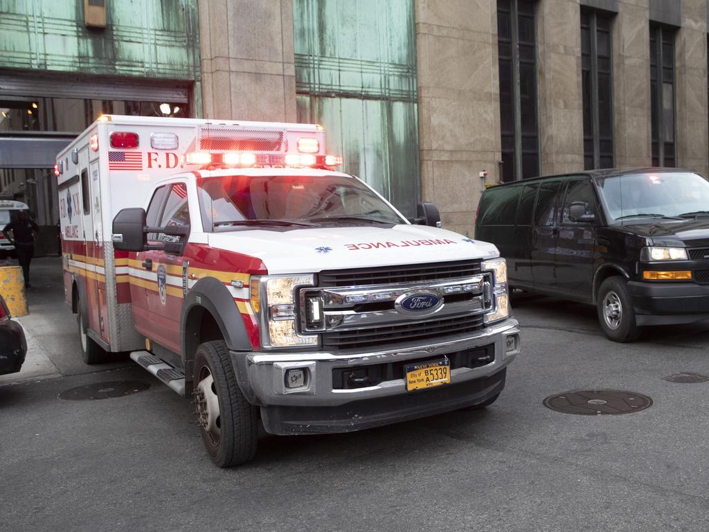 An ambulance carrying Harvey Weinstein is escorted from a Manhattan courthouse. Picture: Mary Altaffer/AP