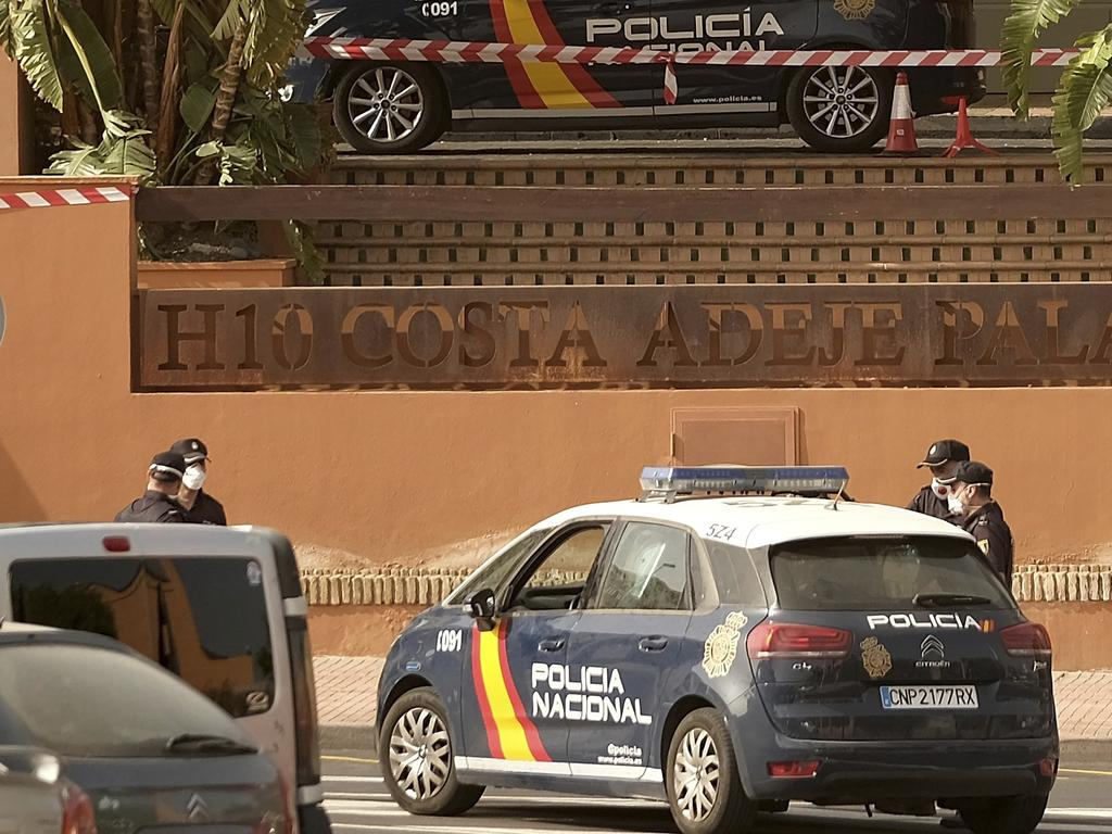 Spanish police officers outside the hotel, where a doctor has been placed in quarantine. Picture: AP Photo.