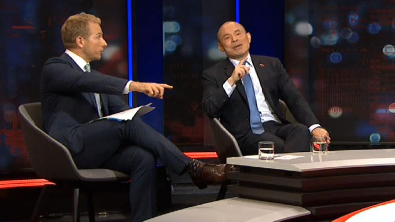 Hamish Macdonald (left) and Wang Xining on Q&A.
