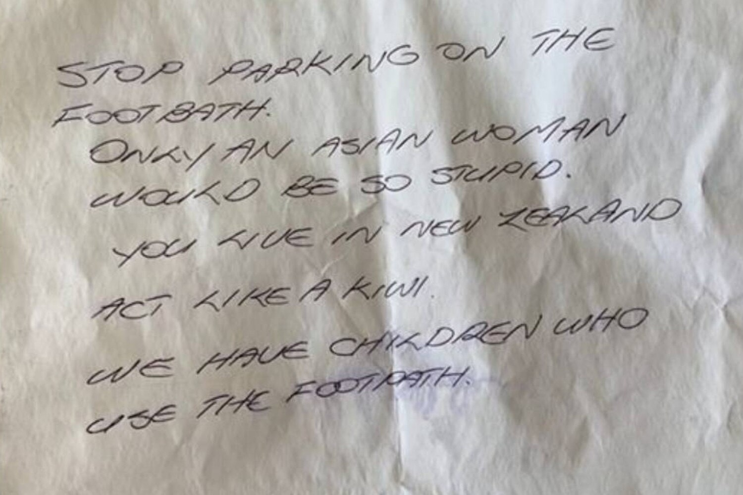 A woman has shared the racist note left on her car after she parked on the footpath. Picture: Supplied
