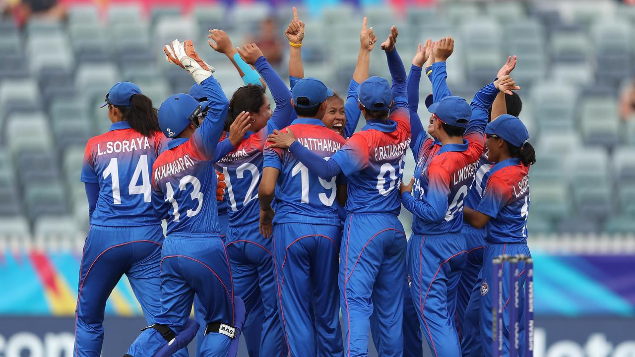Shining on the big stage... Thai players celebrate during their opening clash with the West Indies. Picture: Getty