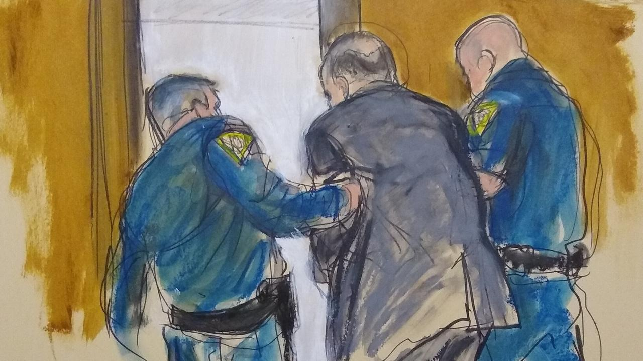 In this courtroom sketch, Harvey Weinstein, is led out of Manhattan Supreme Court after a jury convicted him of rape and sexual assault. Picture: Elizabeth Williams via AP