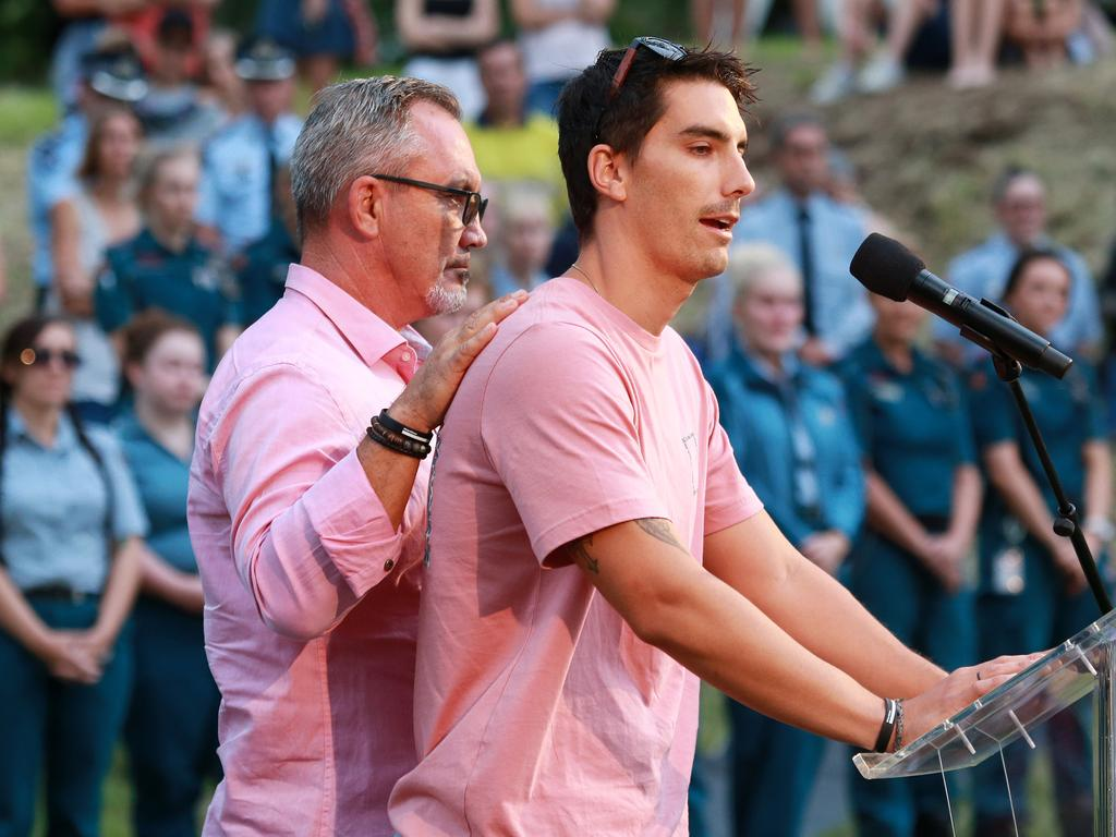 Hannah Clarke's brother Nathaniel Clarke, being supported by his dad Lloyd, while speaking about the family at a public memorial at Bill Hewitt Reserve in Brisbane. Picture: Sarah Marshall