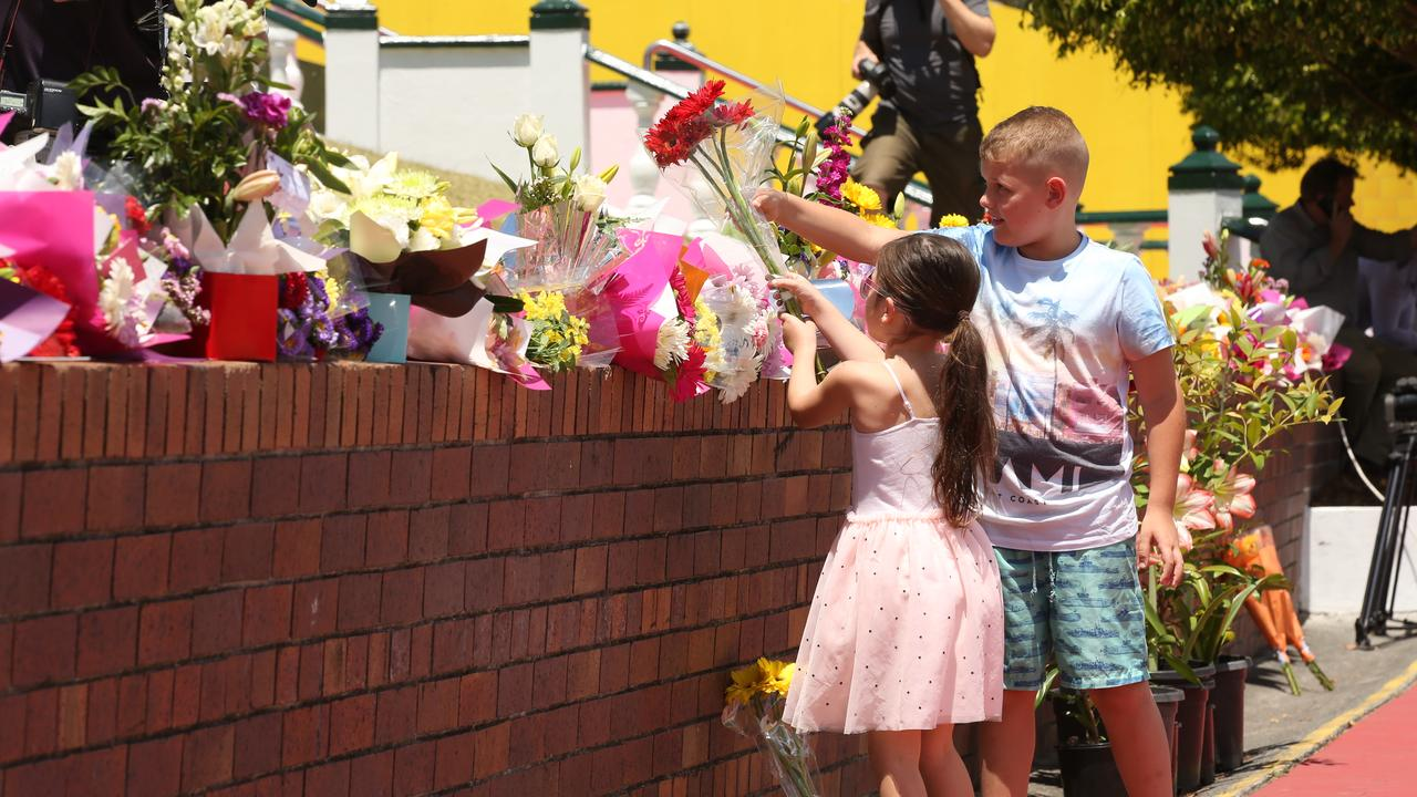 Gold Coasters and tourists lay wreaths and flower tributes to the four people who died on the Thunder River Rapids Ride. Picture: Lyndon Mechielsen/The Australian