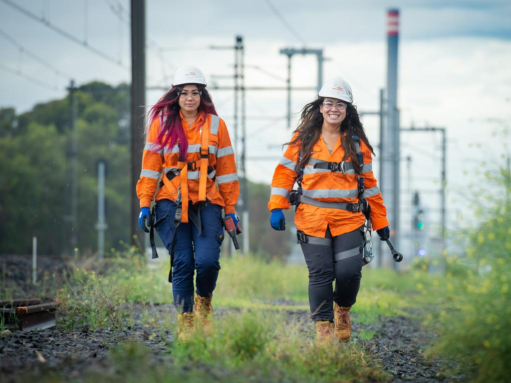 John Holland rail apprentices Leanne Tran and Kerrie Griffin at work in the Melbourne suburb of Newport. Picture: Jay Town